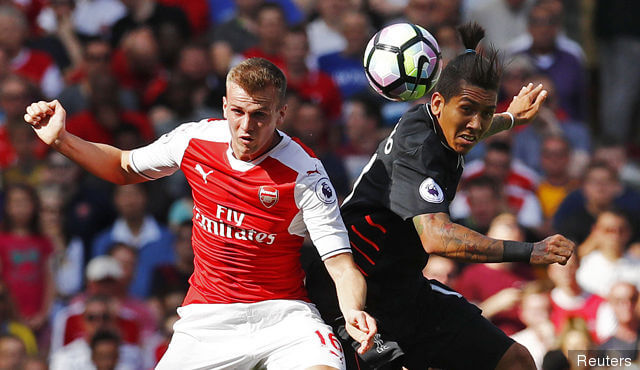 arsenals_rob_holding_in_action_with_liverpools_roberto_firmino_275912(1)